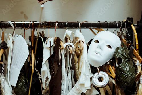 Slika na platnu Mask With Costumes Hanging On Rack