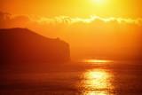 Fototapeta Na ścianę - Scenic View Of Sea Against Orange Sky