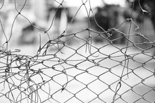 Close-up Of Broken Chain Link Fence