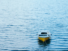 Close-up Of Yellow Boat In Sea