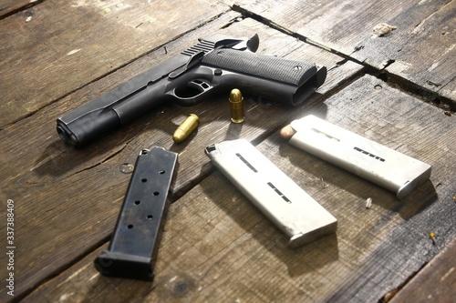 Obraz na plátně High Angle View Of Handguns On Wooden Table