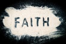Flat Lay Of Faith Word Written On Sand