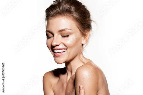 Fototapeta Happy girl with  perfect skin and natural day make-up.