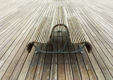 High Angle View Of Wooden Benches On Boardwalk
