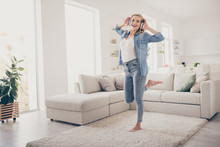 Full Length Photo Of Domestic Pretty Blond Lady Relaxing Dancing Near Couch Stay Home Listen Cool Earphones Favorite Song Quarantine Time Living Room Indoors