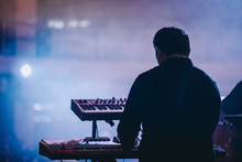 A Musician Playing Synthesizer...