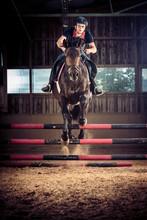Jockey Horseback Riding In Stable