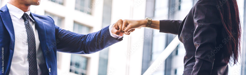 Fototapeta Businessman and partner giving fist bump hand