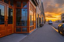 Sunset Reflected In Store Front Windows Of Fort MacLeod, Alberta, Canada