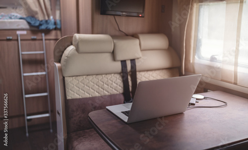 Campervan caravan online nomadic lifestyle travel telework digital nomad  teleworking from away from office workplace inside camper van. Table  workshop on the road remote work quarantine - Buy this stock photo and