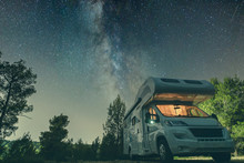 Campervan Caravan Vehicle For Van Life Holiday On Mobile Home Camper Mobile Motor Home RV Campervan For An Outdoor Nomad Lifestyle Camper Van Journey Camping In The Parking Space Night Sky With Stars