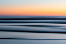 View Of Ocean Waves During Sunset