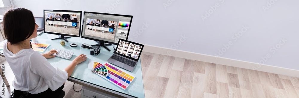 Fototapeta Female Designer Working On Multiple Computer