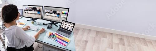 Obraz na plátně Female Designer Working On Multiple Computer