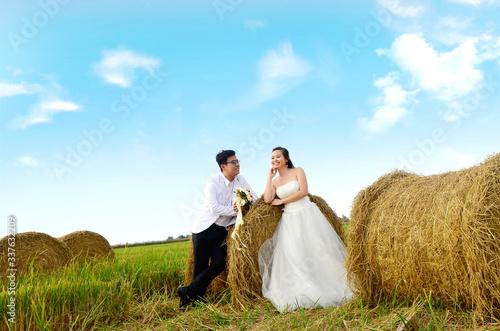 Vászonkép Outdoor portrait of asian bride and groom