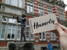 """The Pied Piper Of Hameln Is The Most Famous German Legend.This Photo Shows A Statue In His Hometown Hamelin, Lower Saxony, Germany. View With Calligraphic Inscription """"Hameln"""". Mobile Photography."""