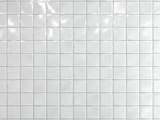 Fototapeta Perspektywa 3d - White squares ceramic tile on the wall. 3d render.