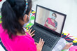 Young student watching lesson online and studying from home. taking online lesson at home, social distance during quarantine, self-isolation, online education concept, home schooling,