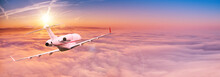 Small Private Jetplane Flying Above Beautiful Clouds. Travel And Transportation Concept.
