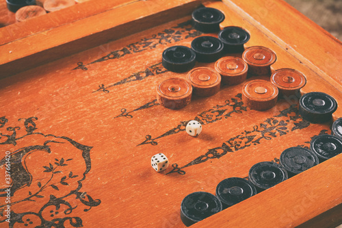 Fototapeta Old wooden backgammon board game