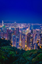 Night Time View Of Hong Kong And Kowloon Skyline As Seen From Victorial Peak