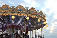 Low Angle View Of Carousel Against Sky