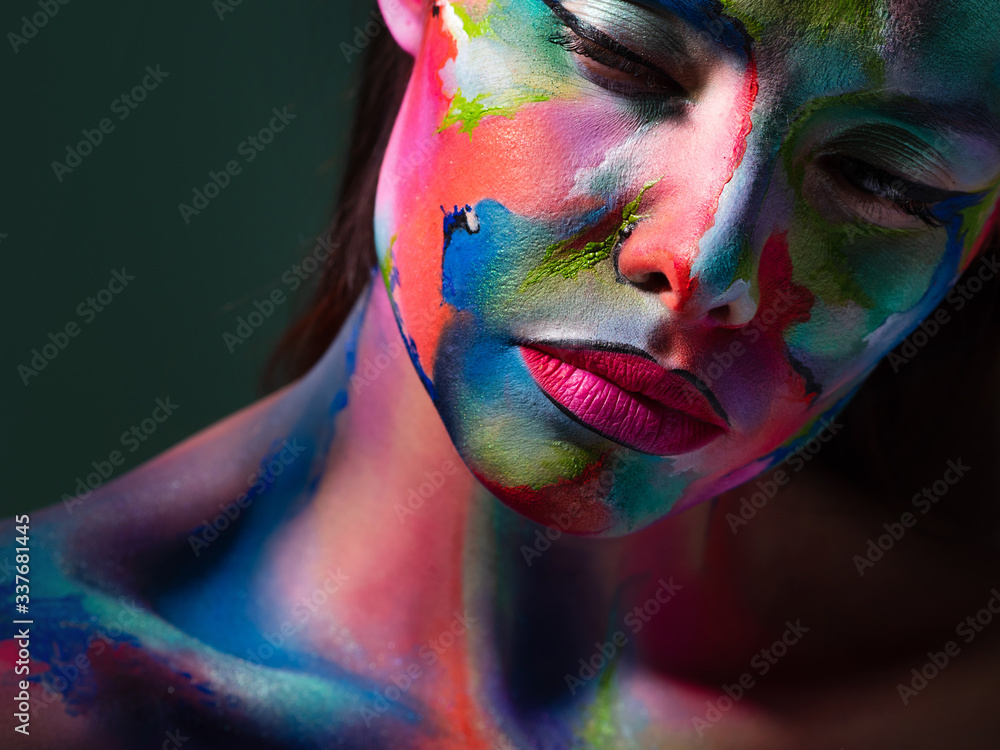 Fototapeta Face art and body art. Creative makeup with colorful patterns on the face. Modern makeup art, bold style, - obraz na płótnie