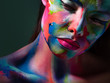 Face art and body art. Creative makeup with colorful patterns on the face. Modern makeup art, bold style,