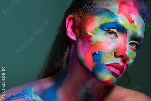 Fototapeta Face art and creative makeup, a young beautiful woman abstract art on the face obraz na płótnie