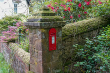UK Red Post Box In A Brick Pillar