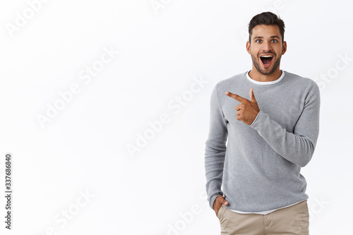 Fototapeta Fascinated happy and excited handsome young male coworker discuss boss new car,