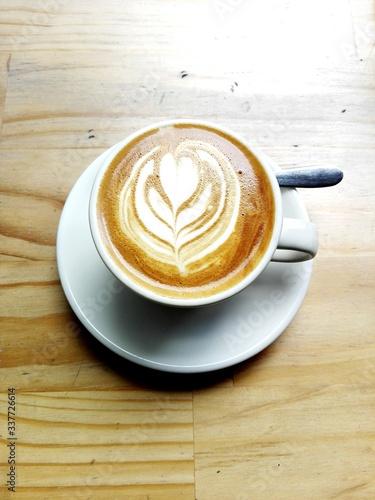 Carta da parati High Angle View Of Cappuccino On Table