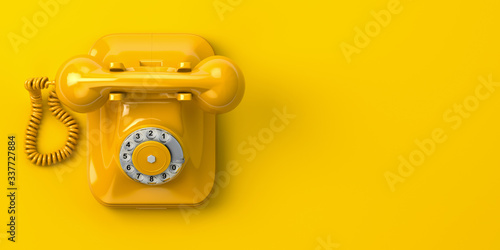 Fototapeta vintage yellow telephone on yellow background. 3d illustration obraz