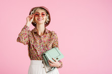 Fashion Portrait Of Young Elegant Happy Smiling Woman Wearing Trendy Spring Outfit: Floral Print Blouse, Pink Bucket Hat, Sunglasses, Holding Stylish Green Faux Leather Bag. Copy, Empty Space For Text