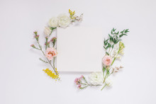 Elegant Floral Composition With Paper Blank In The Centre. Branding Mock Up,  Holiday Marketing Concept.
