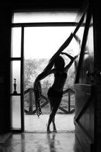 Full Length Of Sensuous Young Woman Standing At Doorway