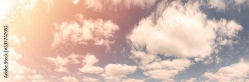 Beautiful landscape of blue cloudy sky with warm sunny tonings Tapéta, Fotótapéta