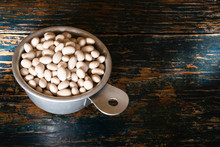 Uncooked Navy Beans In A Measuring Cup