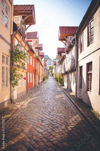 Street Amidst Buildings Against Sky - fototapety na wymiar