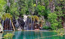 Wispy Waterfalls Flow Into Colorado's Hanging Lake, A Popular Hiking Destination Near Glenwood Springs