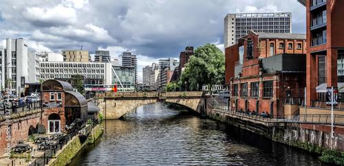 Obraz na plátne Bridge Over Canal In City