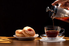 Coffee Brewing In A French Press Pot And Two Donuts In Plate On The Wood Table And Warm Morning Light, Selective Focus.