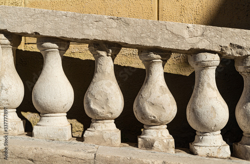 The squat stone columns of the balustrade of the Ponte San Michele in Vicenza Canvas Print