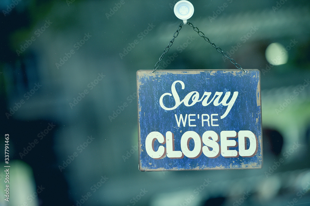Fototapeta Blue closed sign in the window of a shop displaying the message