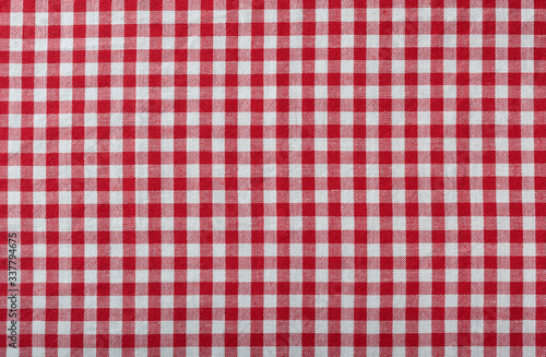 red checkered fabric tablecloth as background Fototapeta