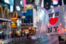 """An Umbrella With """" I Love NY"""" Logo Text."""