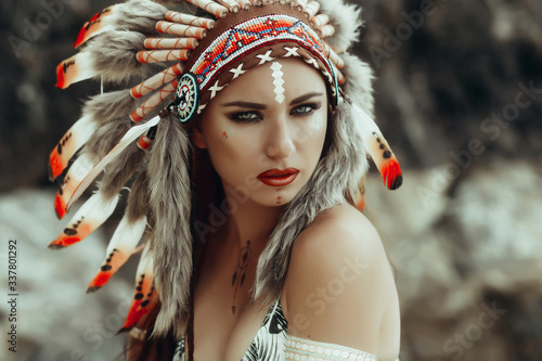 Fotografie, Obraz Fashion portrait in native american style, beautiful girl in Indian hat, trendy color photo processing