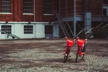 Two Vivid Red Rental Bikes Par...