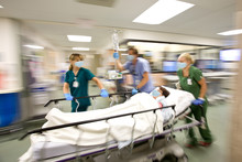 Nurses Rush Patient On Gurney ...