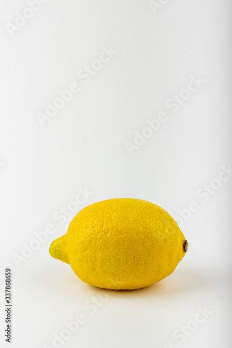 A delicious yellow lemon against a white background.